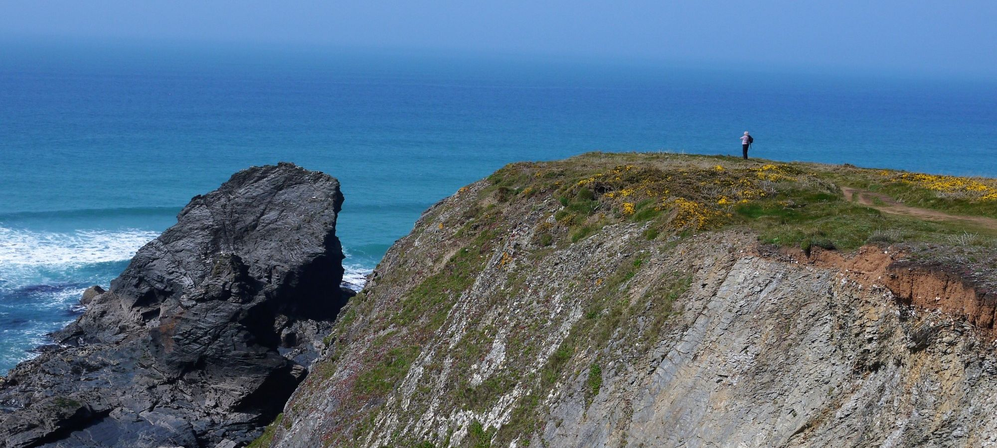 Walker on high cliff top