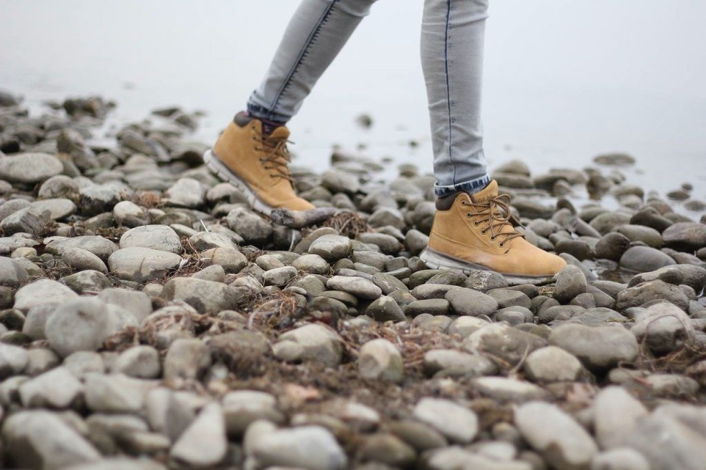 walker on a pebble beach