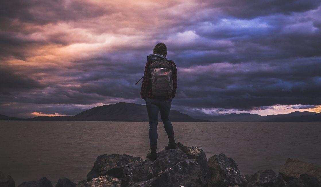 hiker looking across a lake