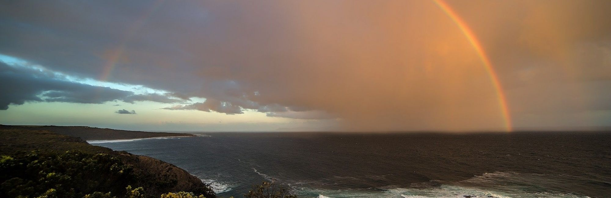 rainbow over stormy seas
